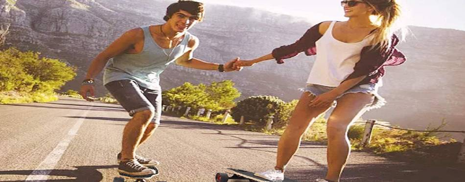 Boy and girl are carving on the longboard