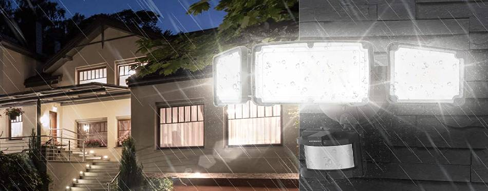 Flood lights attached to the house in the rain