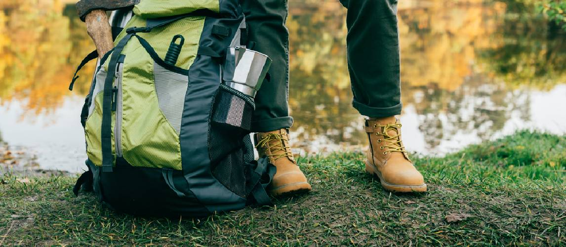 traveller legs with backpack hiking