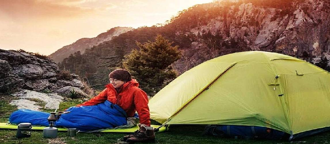 Camper wakes up in the mountain morning