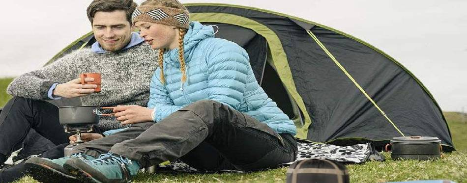A couple is having a great relaxing time outdoor camping