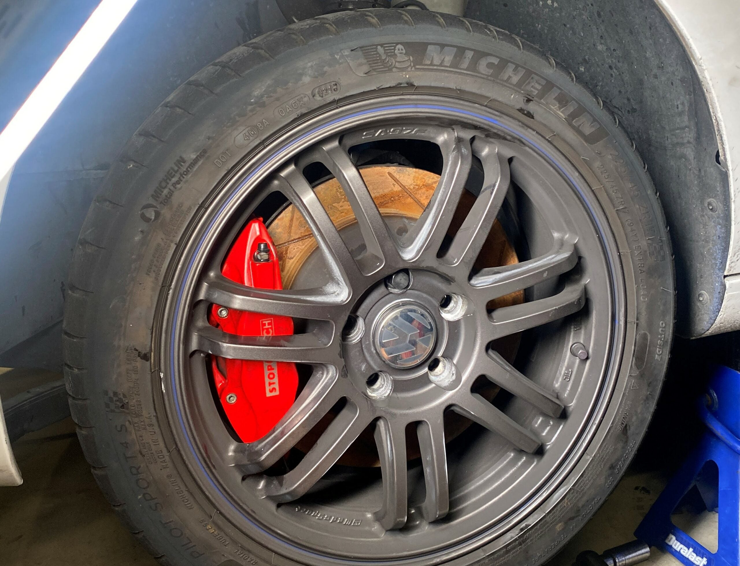 stop tech big brake kit installed on mk6 golf with rusty rotors from storage