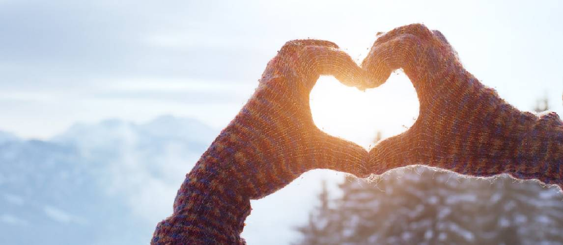Heart made with hands in winter gloves