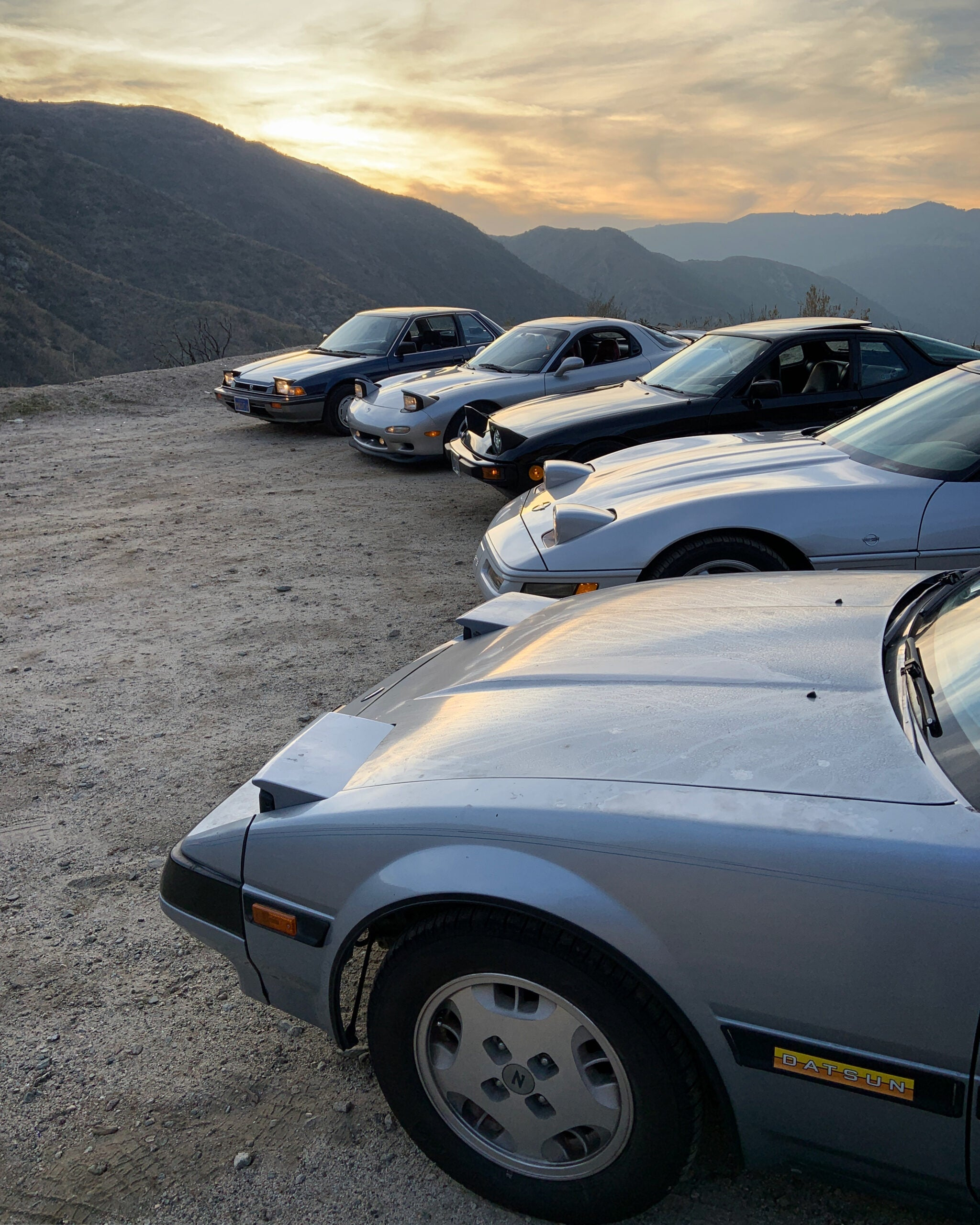 Cars parked on canyon road.