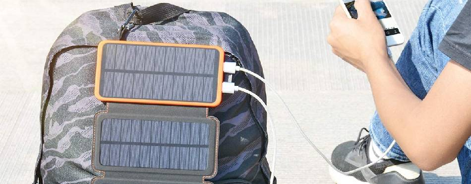 Solar backpack charger used for charging a smartphone