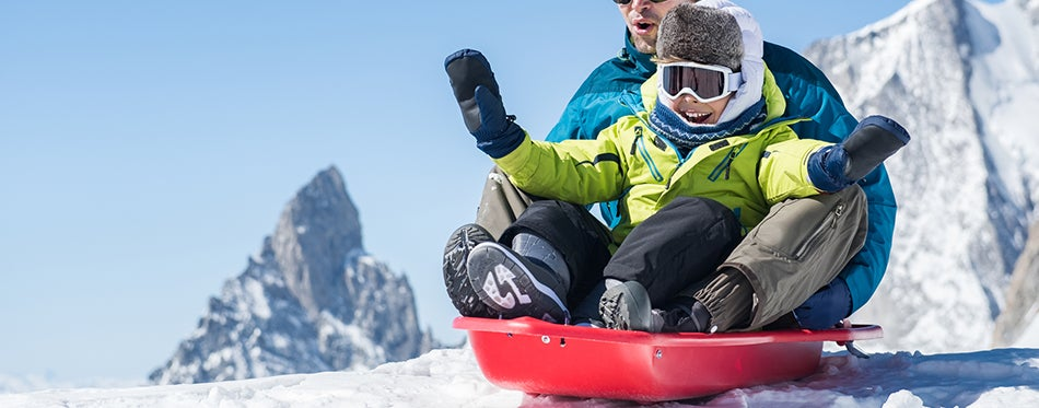 Father with son sledding with the best sleds