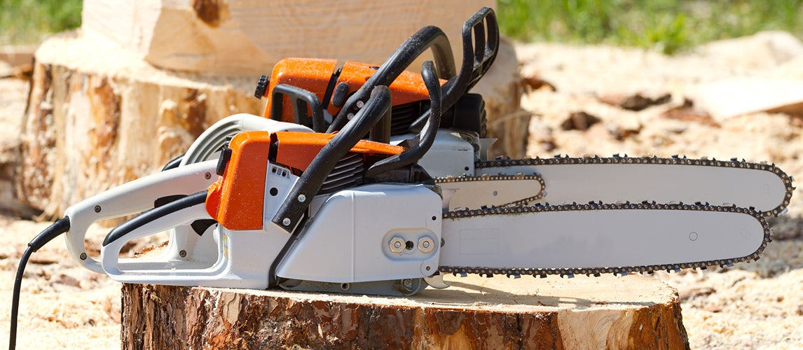 two electric chainsaws used to cut wood