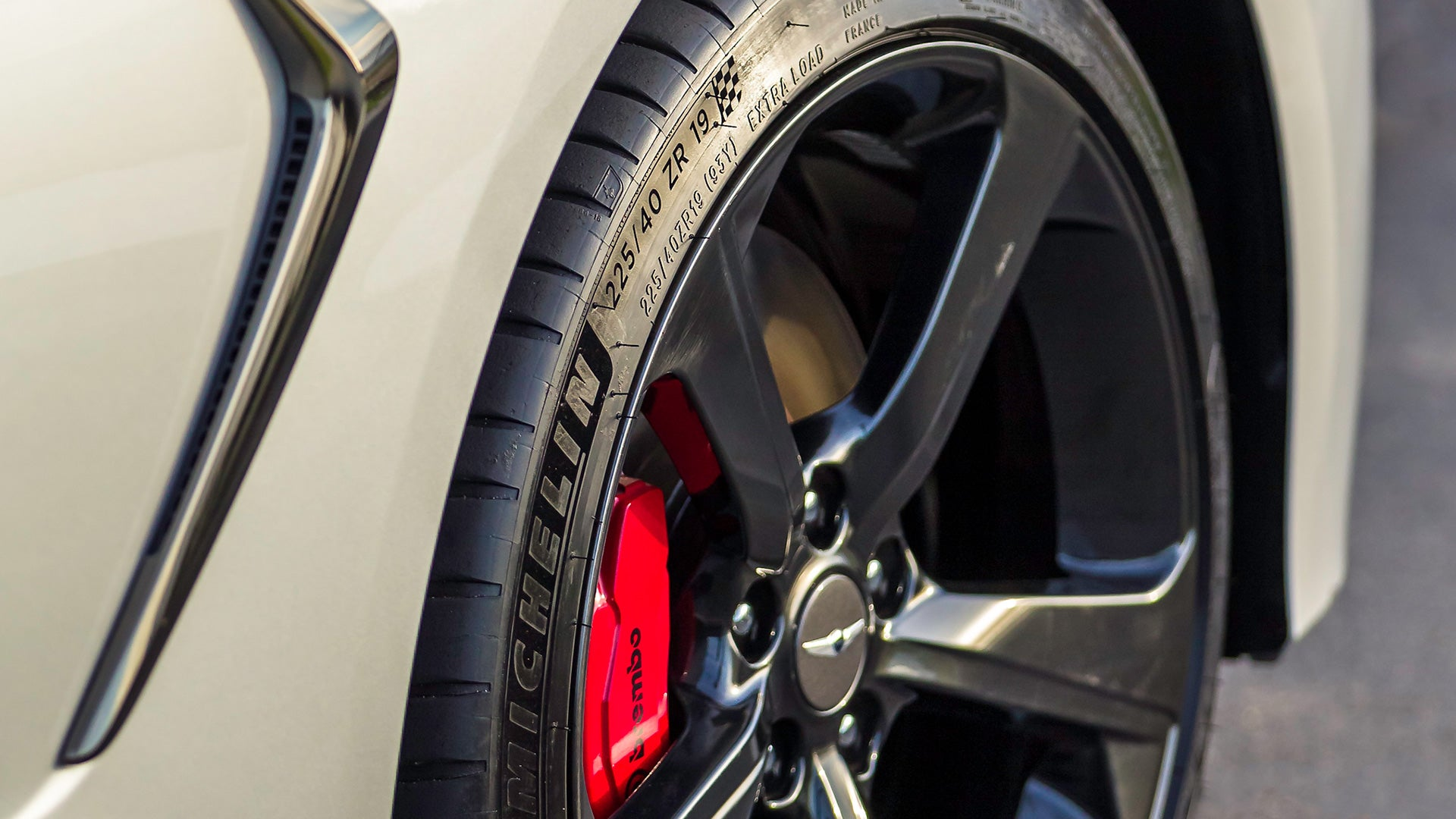A close-up of a Genesis G70 wheel and tire.