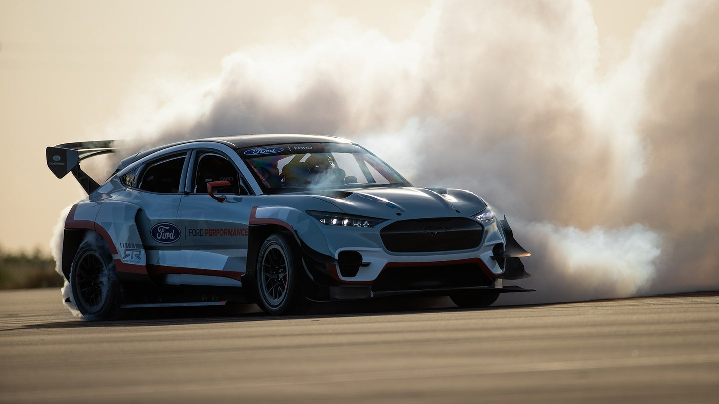 A Ford Mustang Mach-E drifting on track.