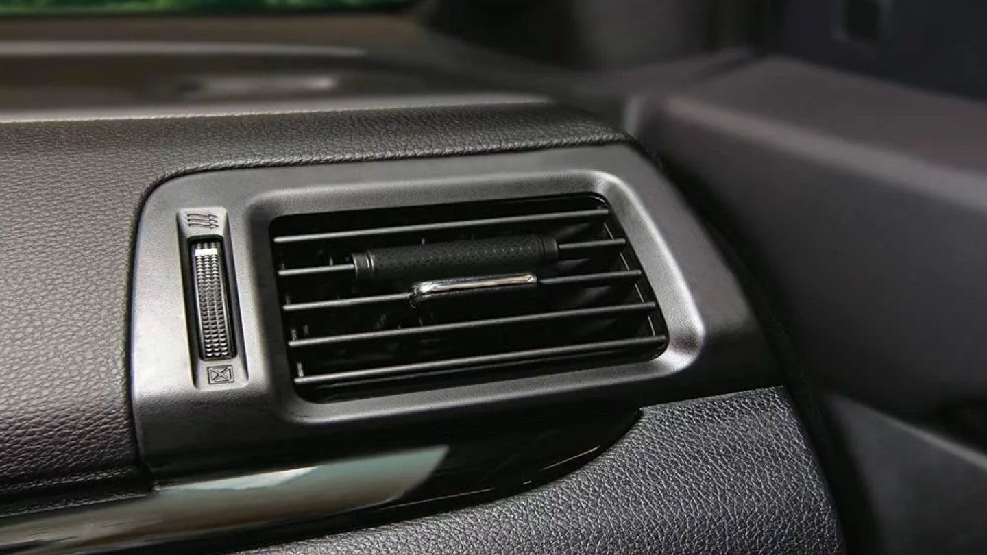 Car air freshener on a vent grill
