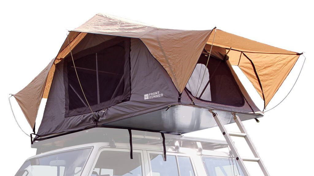 A multi-colored Front Runner rooftop tent unfolded and setup on top of an SUV.