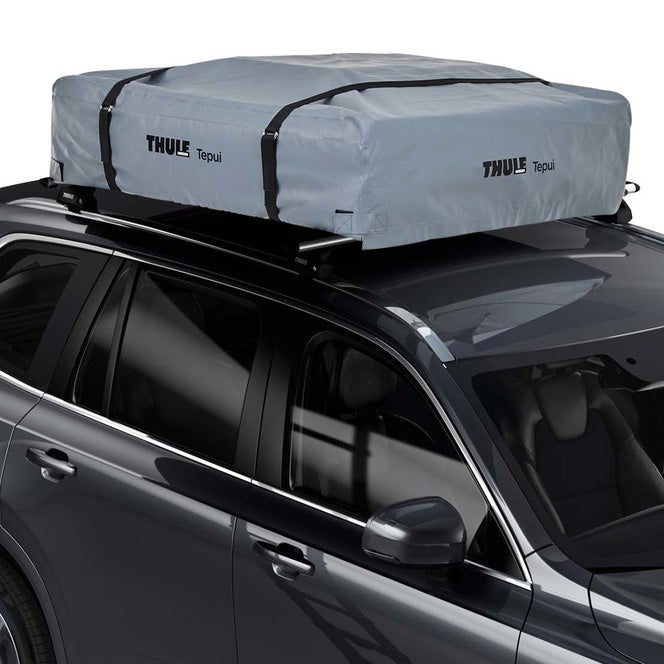 A Thule rooftop tent installed on top of a Volvo XC90.