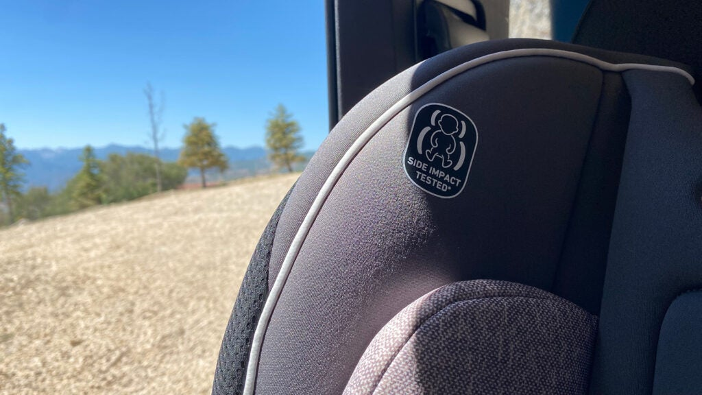 The shoulder of a child car safety seat.