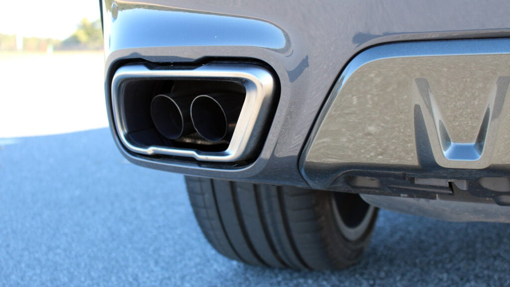 A close-up of a BMW X6 M50i exhaust tip.