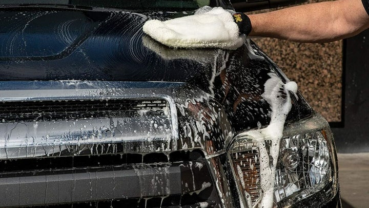 Cleaning car with car wash soap