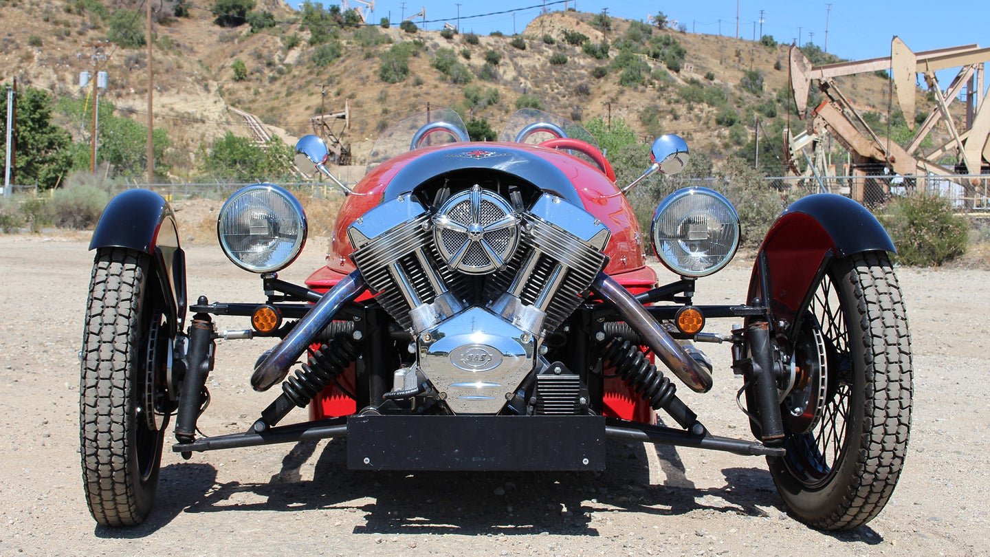 A red Morgan 3-Wheeler flashes its nose full of bright chrome in L.A.'s mountains.