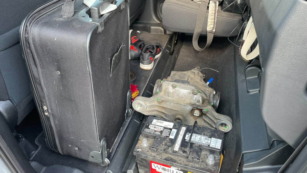 Suitcase, differential, and personal belongings on the floor of the 2021 Ridgeline