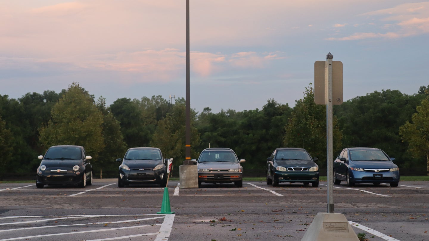 Five cars in a parking lot