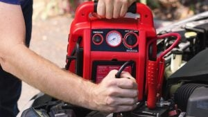 Man is using Best Portable Jump Starters