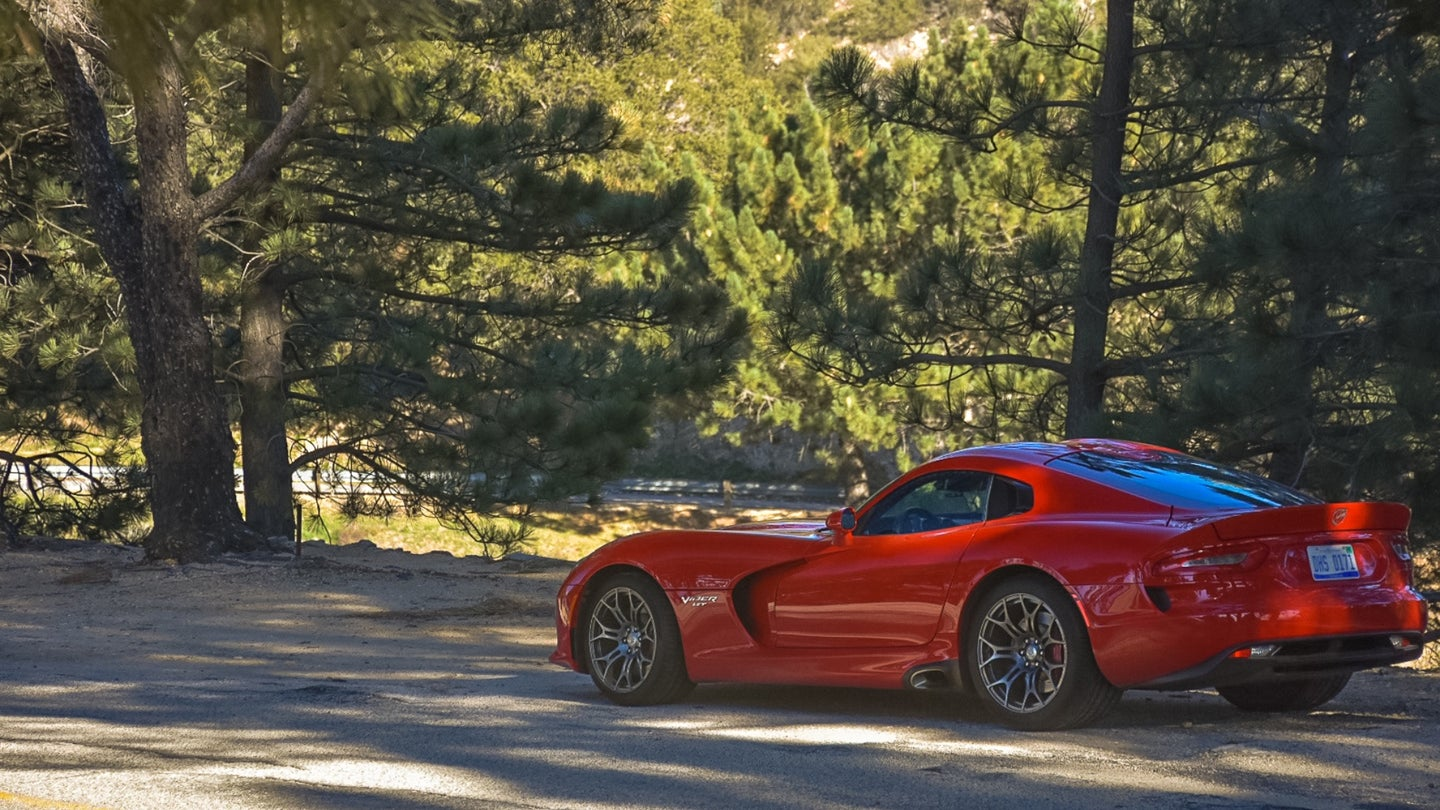 A Dodge Viper lurking in the forest.