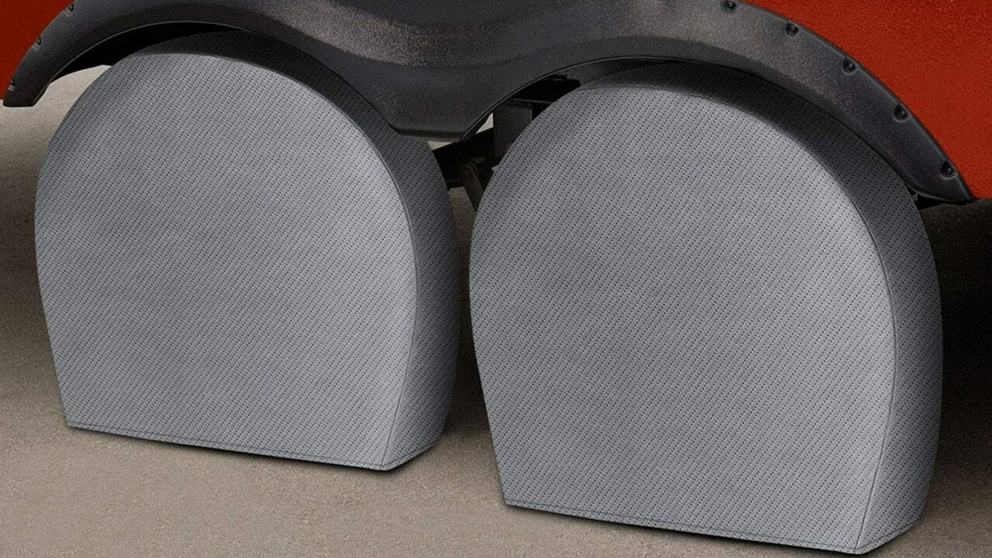 A set of grey wheel covers for trailer tires