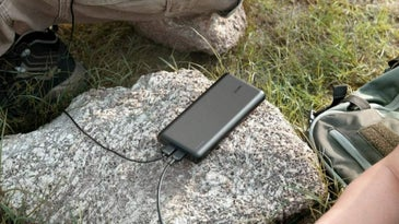 30000 mah portable charger in nature charging two phones